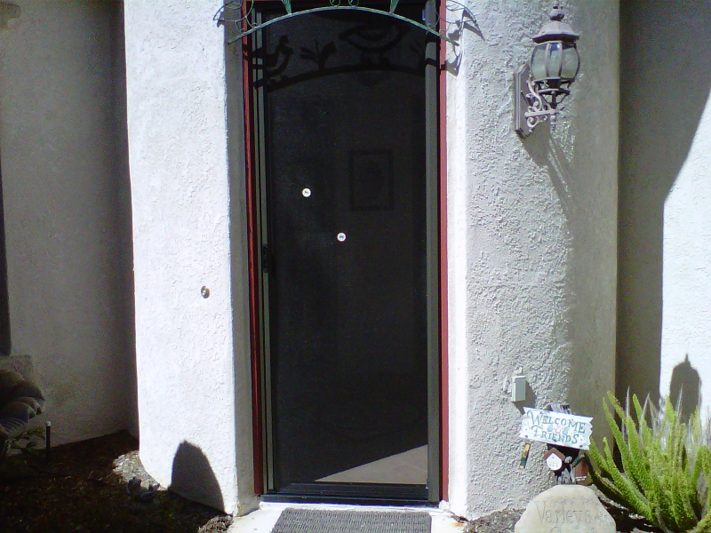 Bronze Roll-Away Invisible Screen Door in use with decals