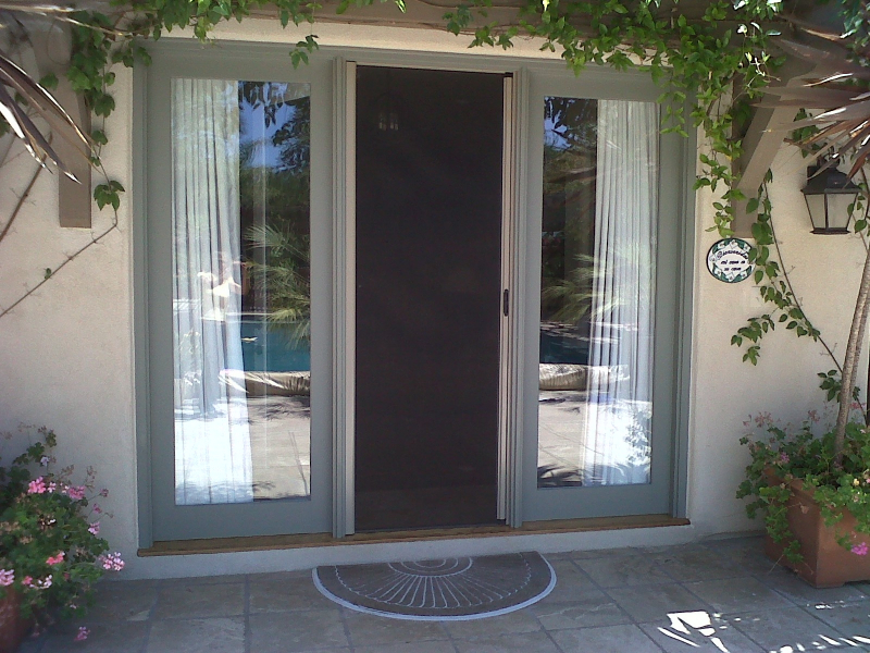 Champagne Beige Roll-Away Retractable Screen Doori n use for guest house