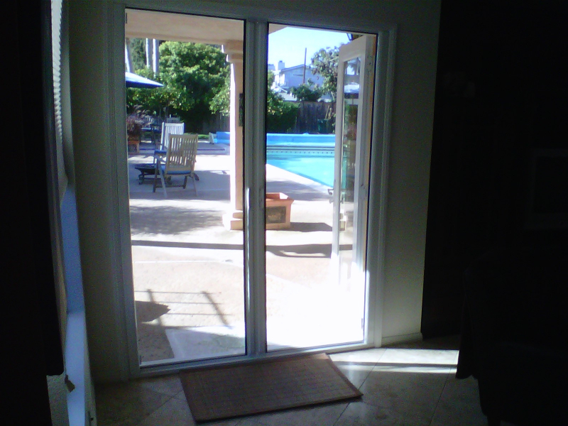 White French Roll-Away Retractable Screen Doors with inside mount for outswinging double doors