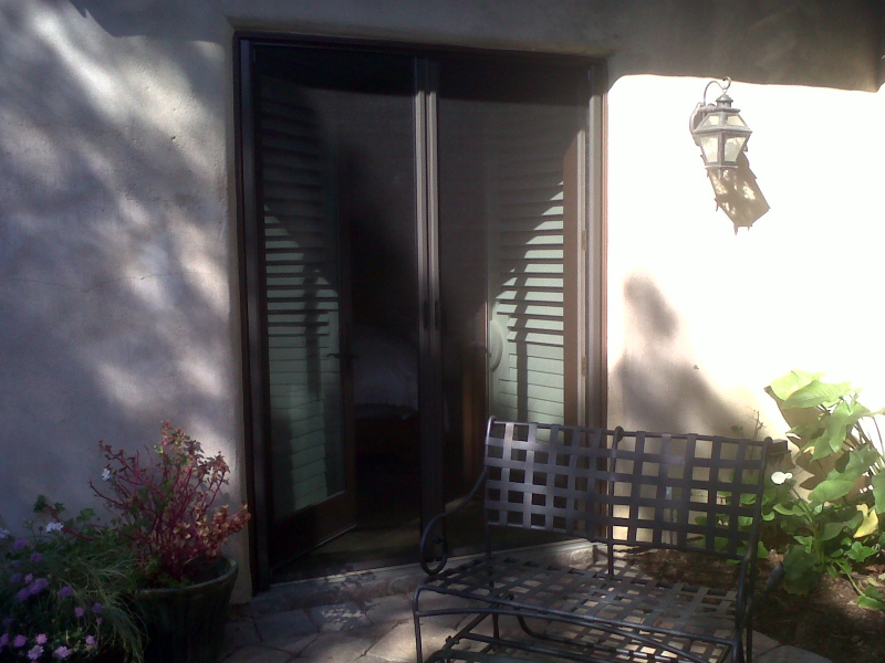 French Bronze Roll-Away Disappearing Screen Doors in use