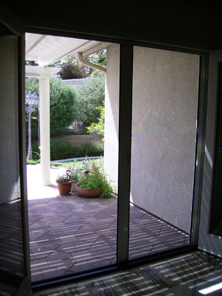 White French Roll-Away Disappearing Screen Doors from inside