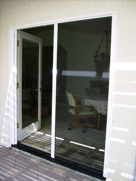 White French Roll-Away Retractable Screen Doors with fixed door locked in place