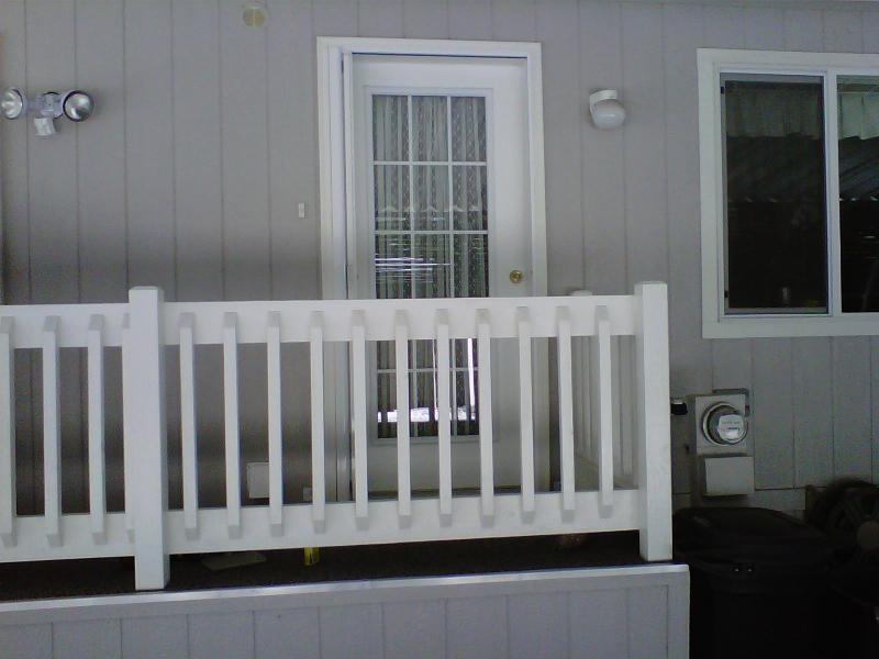 White Roll-Away Retractable Screen Door on carport door