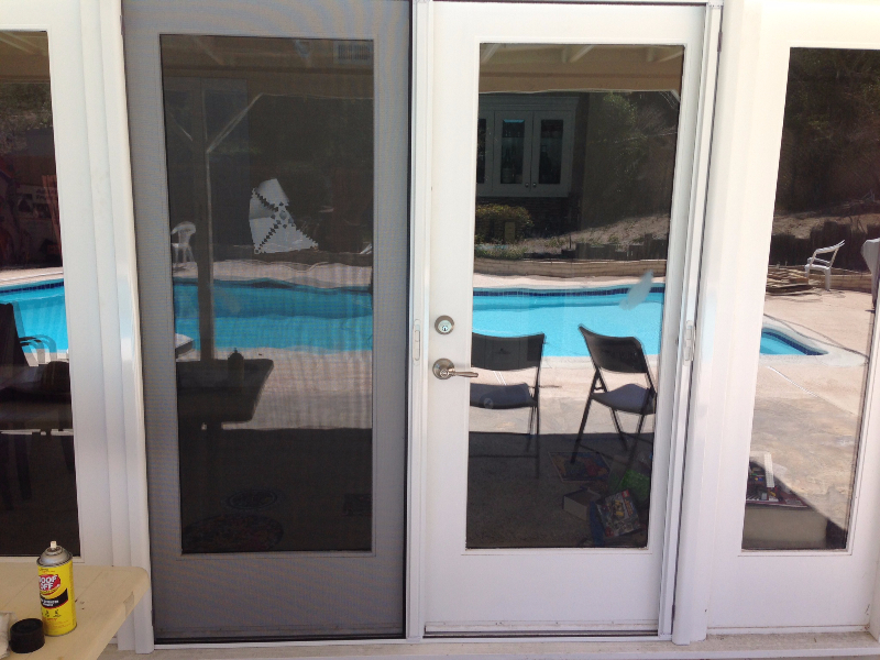 white_french_roll_away_screen_doors_with_fixed_door_in_place