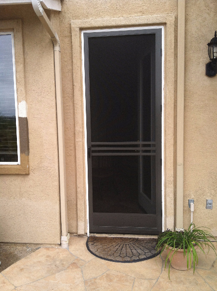 tall_bronze_full_view_swinging_door_with_custom_cross_bars