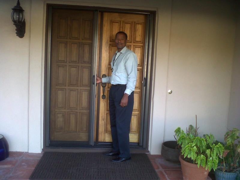 French Bronze Roll-Away Retractable Screen Doors with fixed door in use and happy customer!