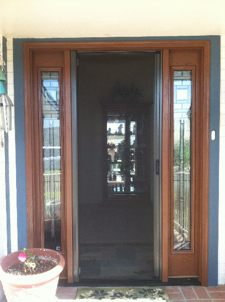bronze_roll_away_disappearing_screen_door_in_use