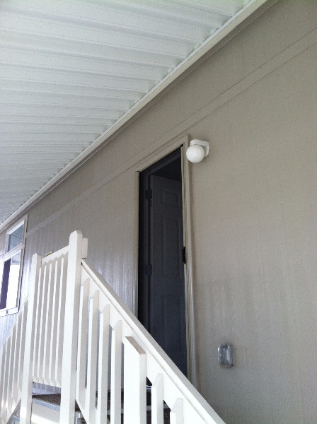 desert_sand_roll_away_retractable_screen_door_in_use_near_staircase