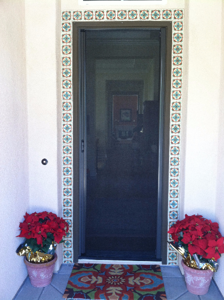 tall_bronze_roll_away_retractable_screen_door_in_use