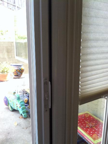 white_roll_away_screen_door_flush_with_door_moulding_on_door_that_swings_out