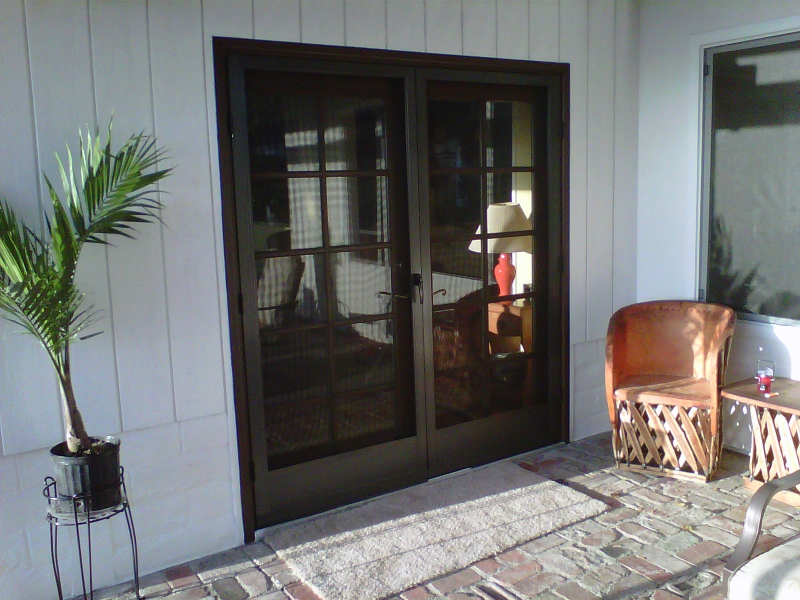 Bronze French Full View Swinging Screen Doors mounted on Colonial french doors